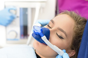 woman using nitrous oxide sedation