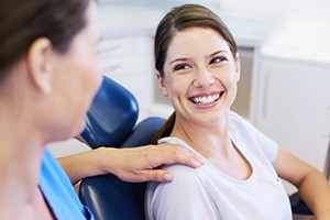 dentist with hand on woman's shoulder