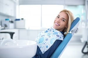 Smiling woman in dentist's chair.