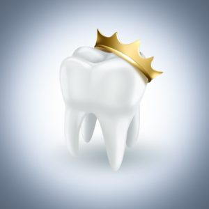 white tooth adorned with golden crown